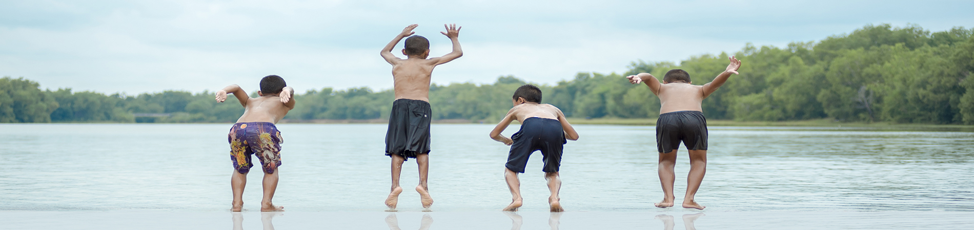 Children jumping in the water