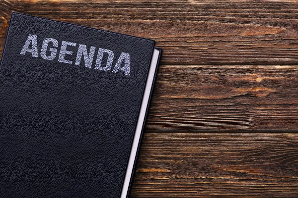 Book with agenda on table